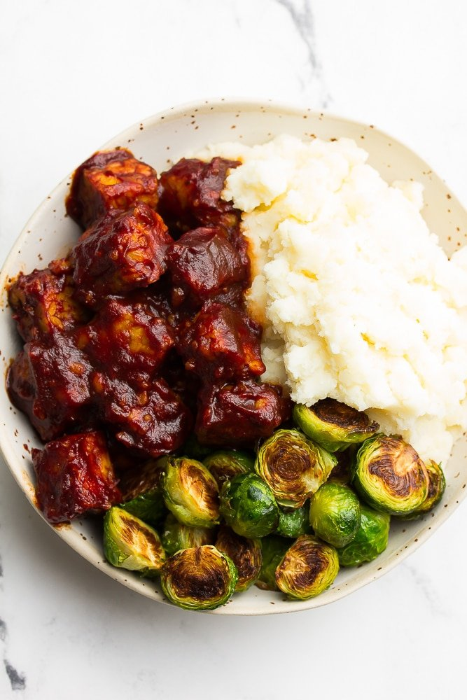 bowl with bbq tempeh, brussels and potatoes