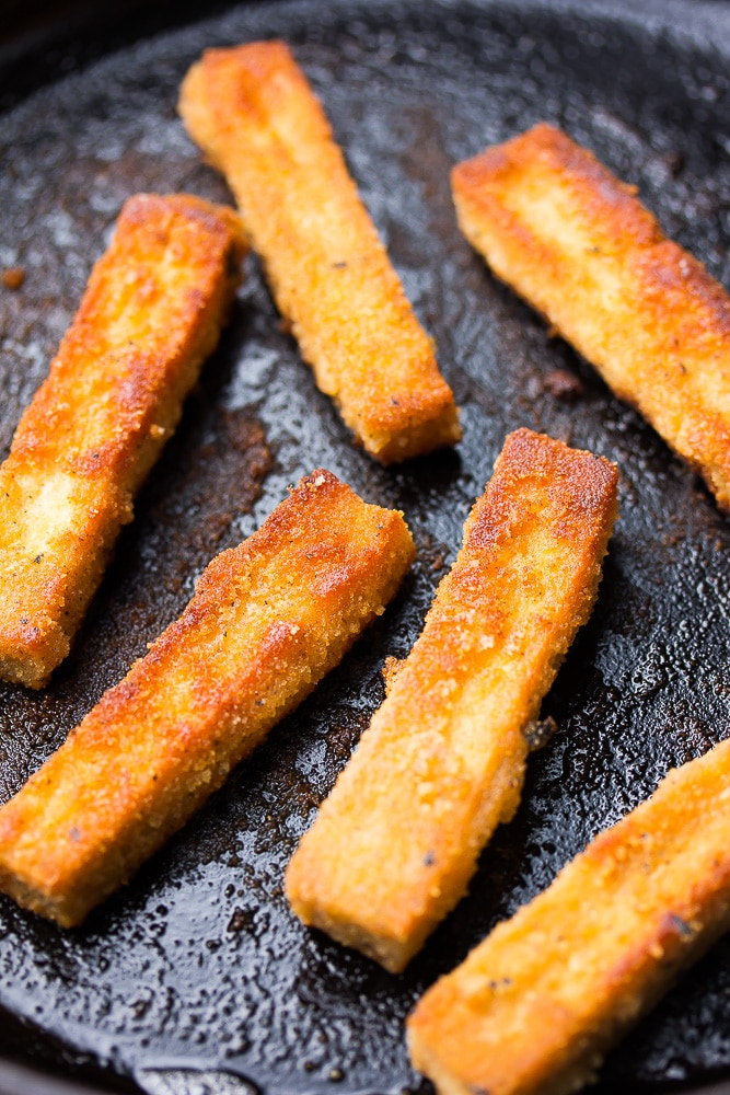 frying tofu sticks on a pan