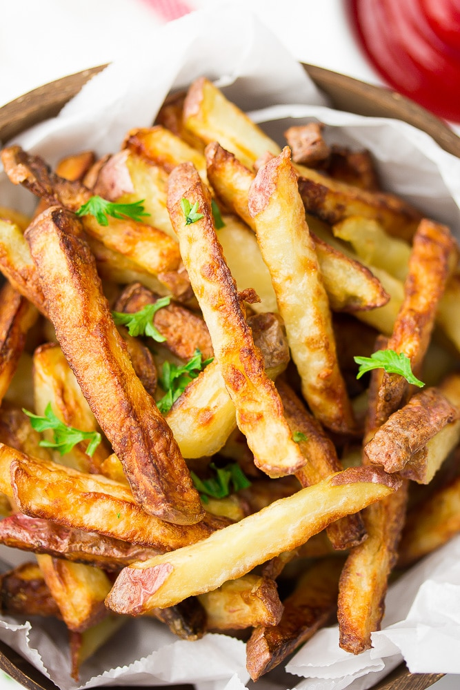 crispy air fryer fries on a plate with parsley