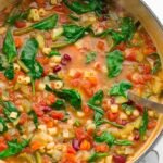whole pot of minestrone soup, green spinach, white pot