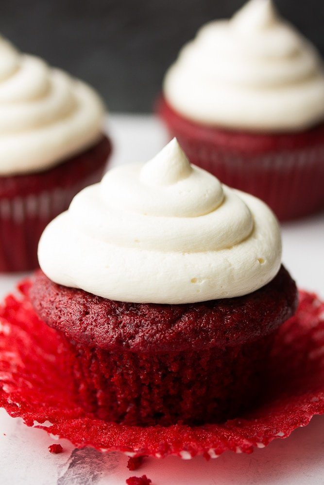 unwrapped red velvet cupcakes with more in back
