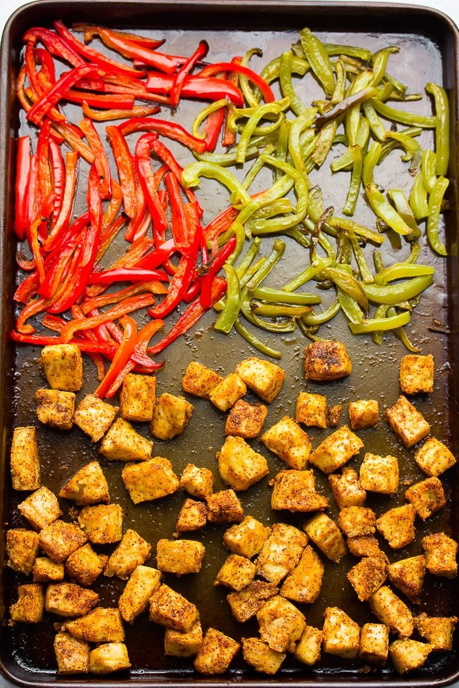 baked crispy tofu and peppers on a sheet pan