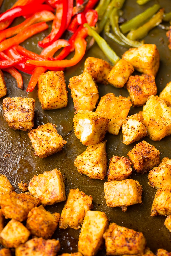 close up of tofu chikn on sheet pan with peppers