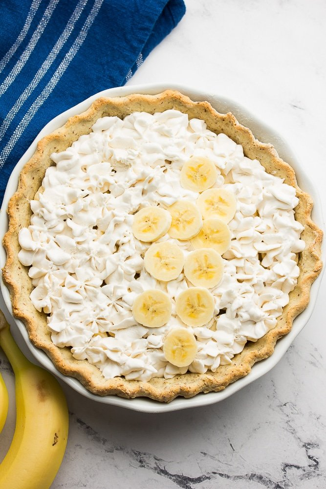 whipped cream and bananas in pie crust