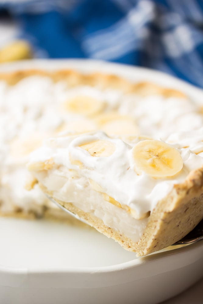 a slice of creamy pie being taken out of pie pan