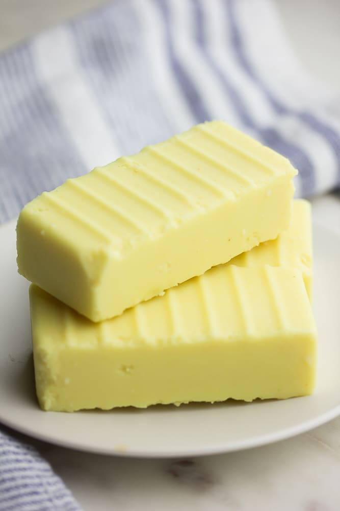 3 sticks of butter with ridges on a plate