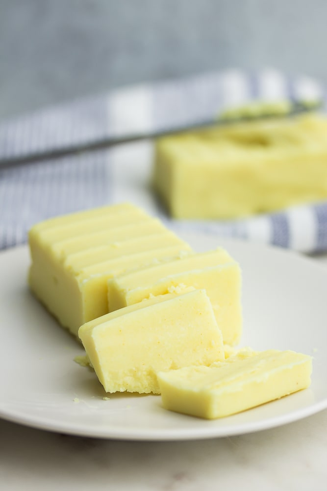 sliced vegan butter on a plate, more in background
