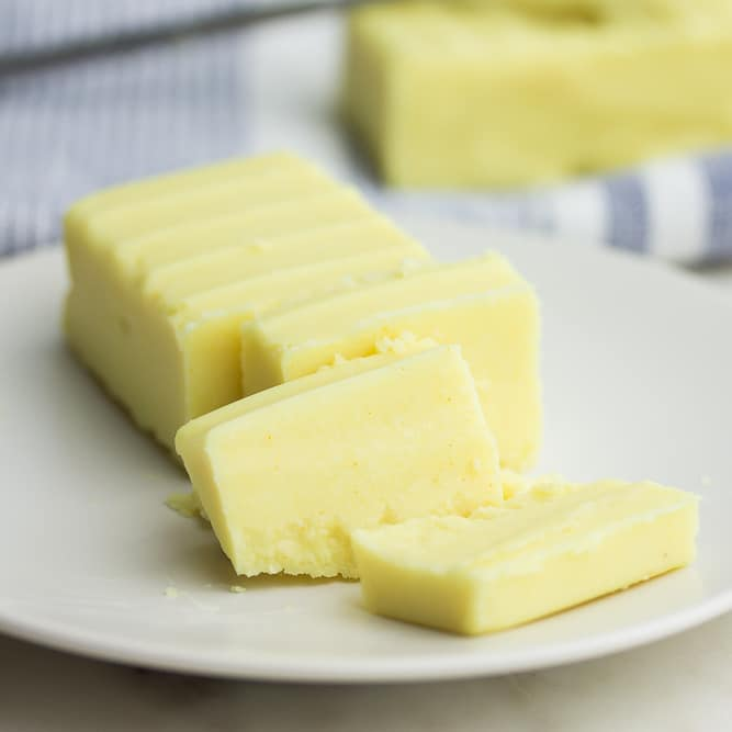 square image of butter being cut