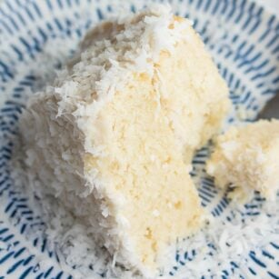 looking down on a piece of coconut cake, bite taken