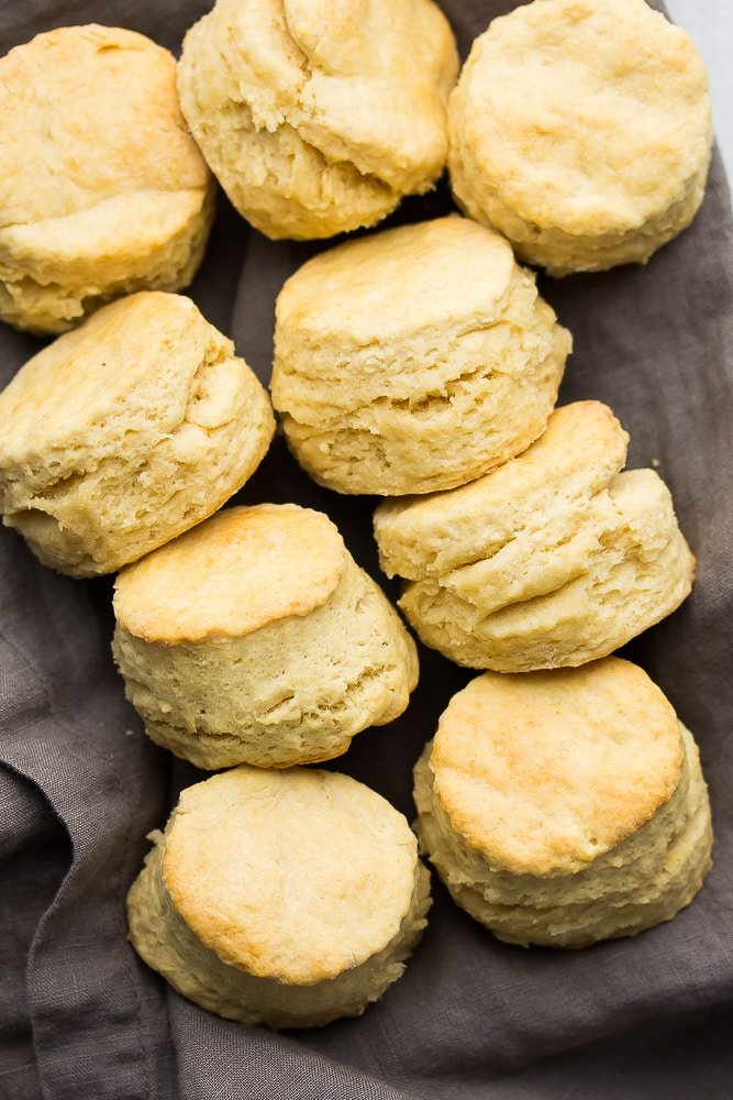 a group of biscuits in a row on a gray towel