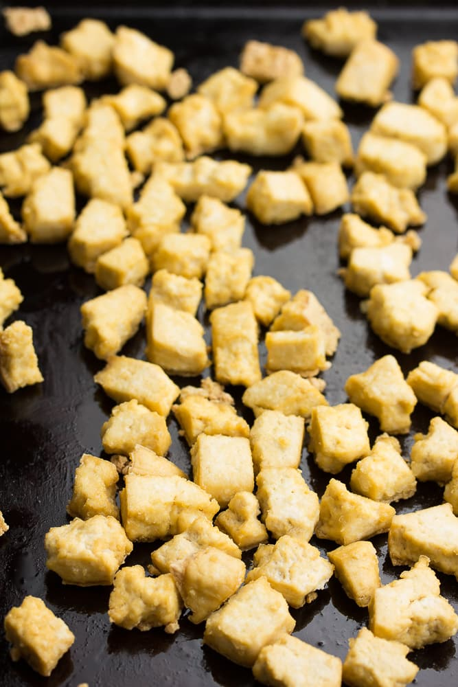pieces of tofu on a baking sheet
