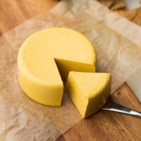 square image of a block of vegan cheddar