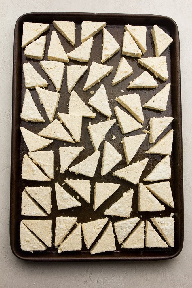 triangle tofu pieces on a sheet pan