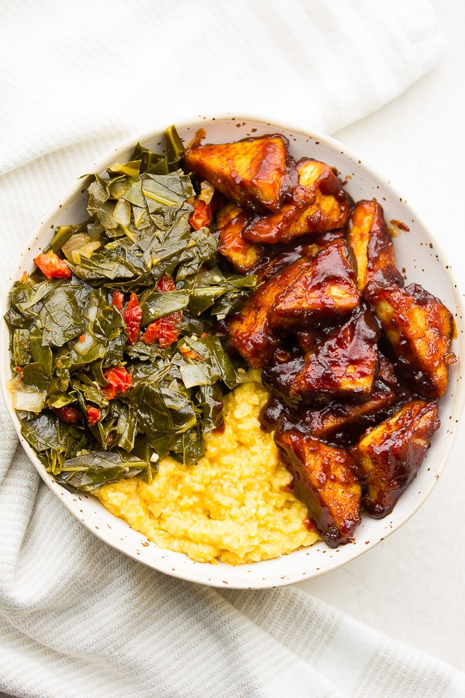 bowl with bbq tofu, grits and collard greens