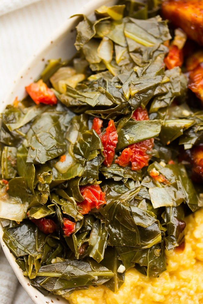 collard greens in a bowl with grits and tofu