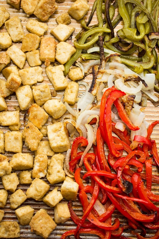 pan full of baked tofu, peppers and onion