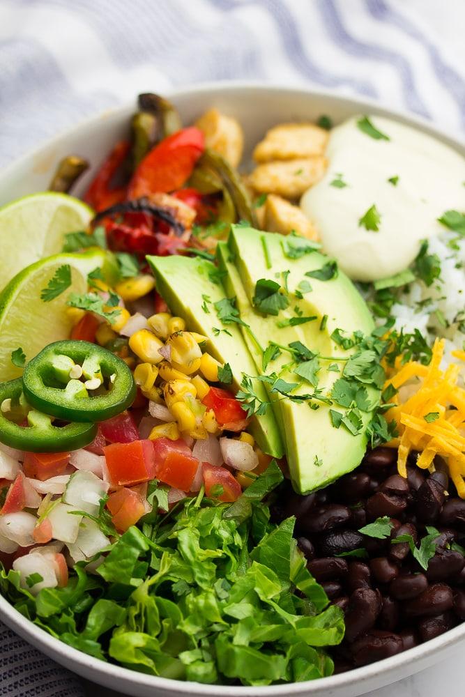 close up of vegan burrito bowl with avocado and cilantro