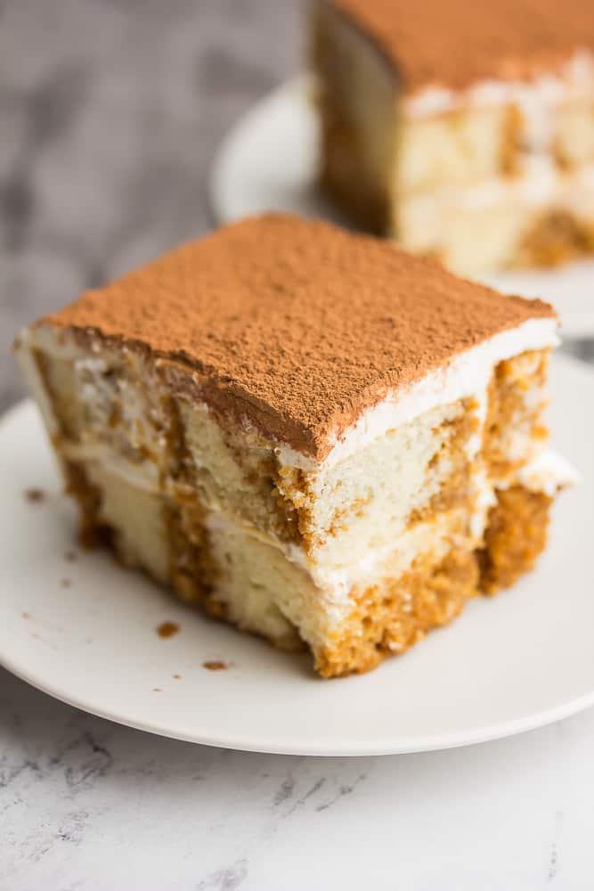 Piece of tiramisu cake on a white plate