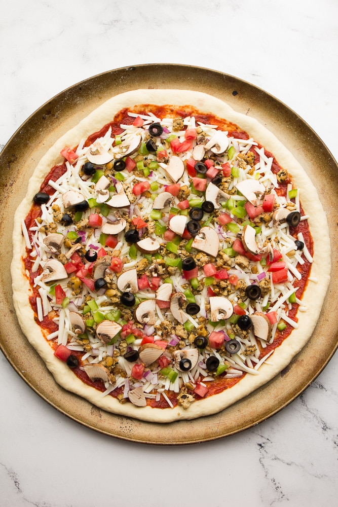 Overhead shot of uncooked pizza