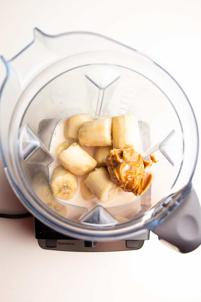 blender full of bananas and peanut butter