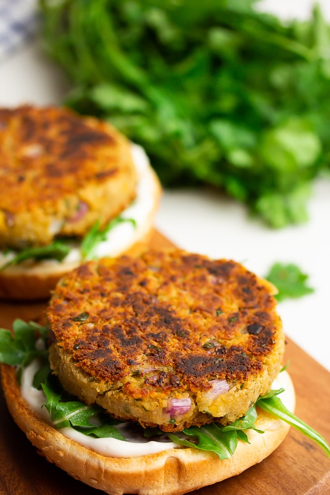 open bun burgers with greens