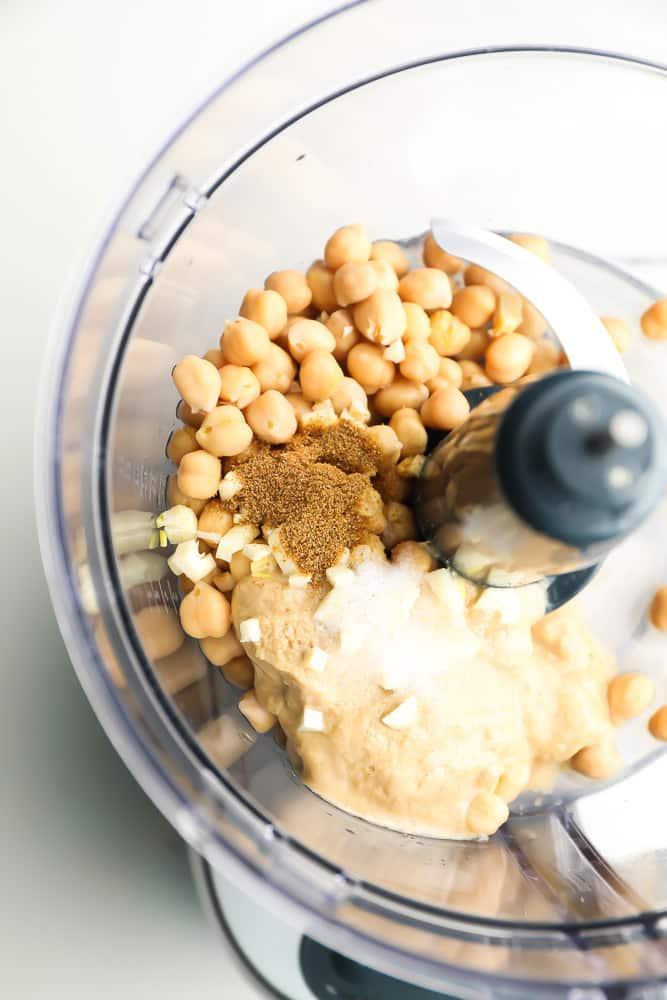 food processor full of hummus ingredients