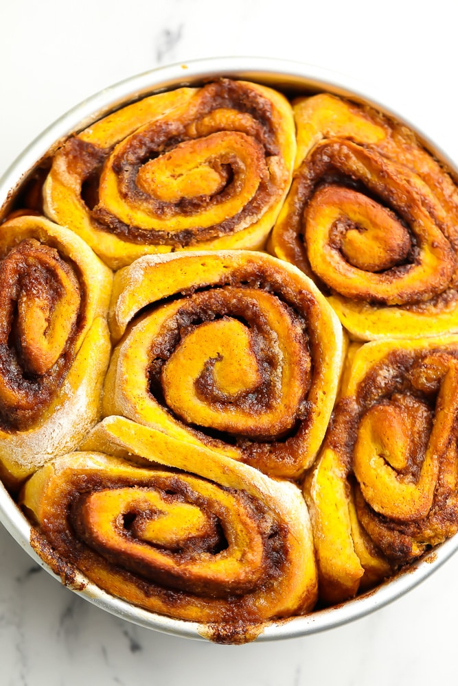 round dish of pumpkin cinnamon rolls, no icing