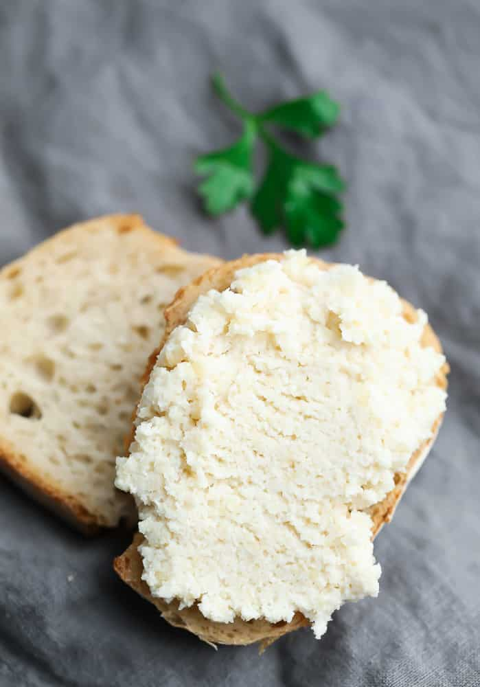 two small slices of bread with ricotta on top