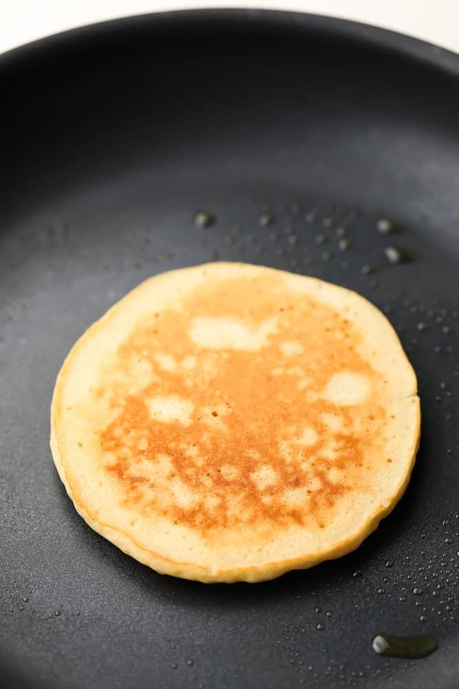 pancakes cooking on a pan