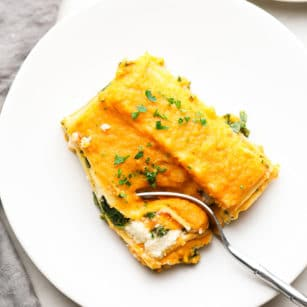 square image of butternut squash lasagna on a plate
