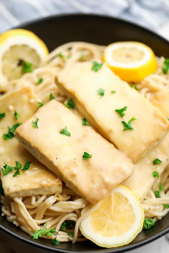 few slabs of tofu over pasta with creamy sauce