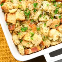 square image of stuffing in white casserole dish