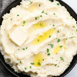 square image of mashed potatoes in black bowl
