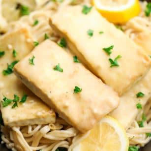 square photo of lemon tofu over pasta