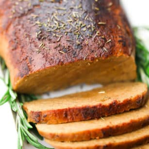 square image of vegan turkey loaf on white plate