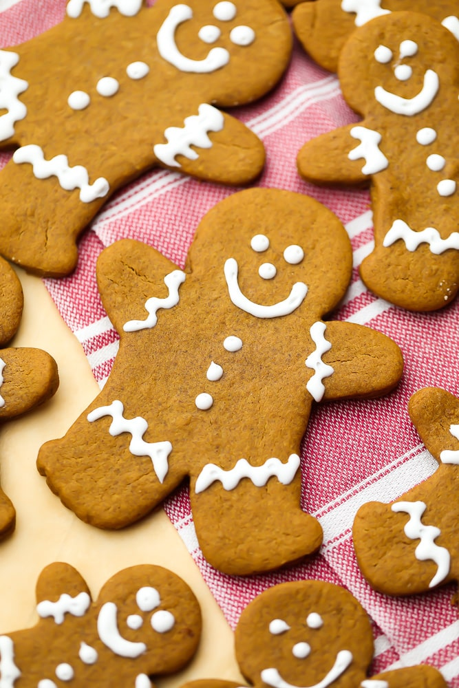 close up of a gingerbread cookie person, more around it