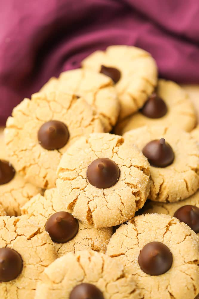 many peanut butter blossoms on top of each other, burgundy towel in back