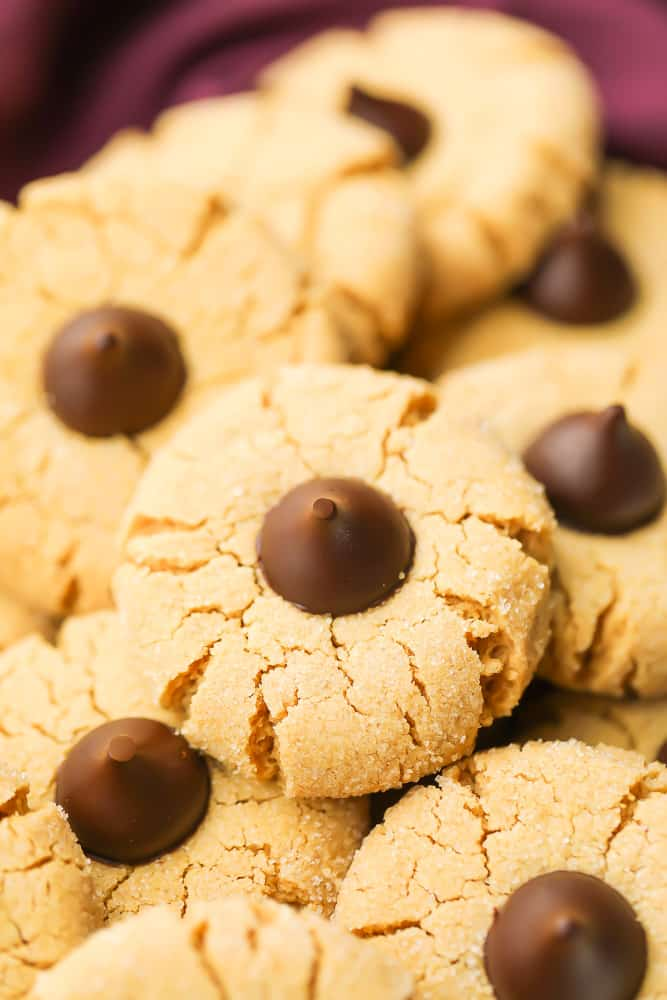 close up of a peanut butter cookie with chocolate kiss in the middle