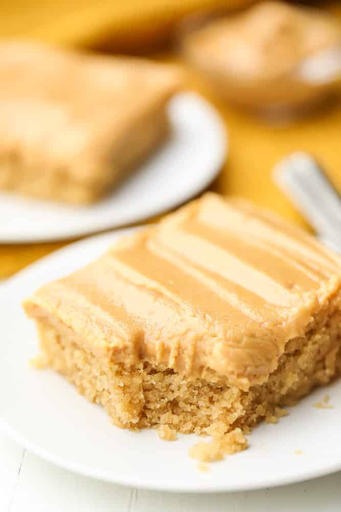sheet cake on a plate with more in background