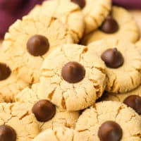 square photo of a bunch of cookies with kisses in the middle