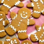 square image of gingerbread people, red towel in back.