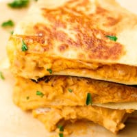 photo of stack of jackfruit buffalo quesadillas