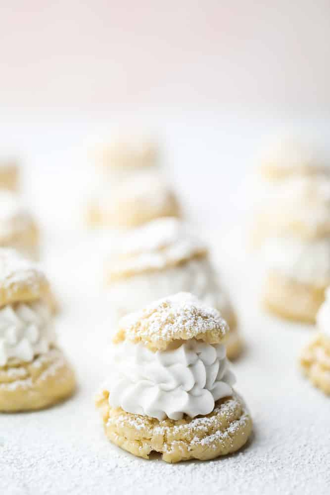 whip cream in choux pastry, pink background