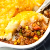 square image of a casserole with cheddar mashed potatoes on top