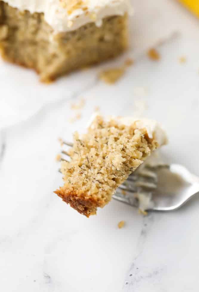 piece of vegan banana cake on a fork showing the texture