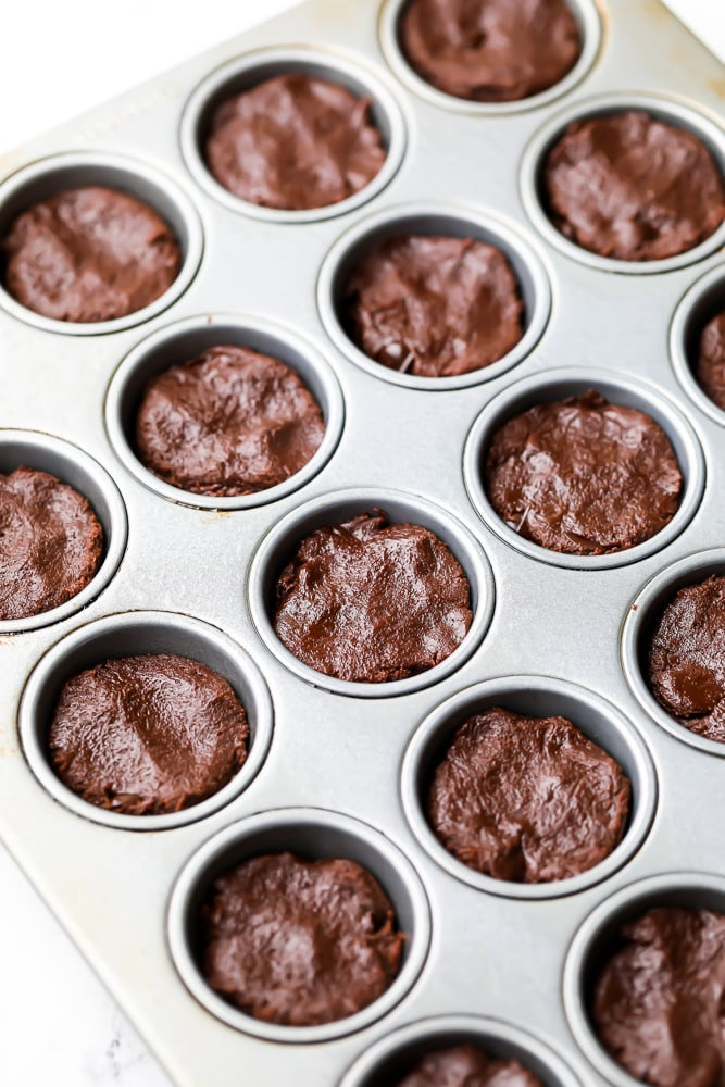 muffin pan filled with brownie batter