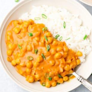 white bowl with chickpea tikka masala and white rice
