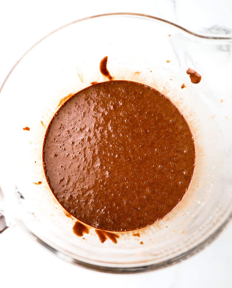 large glass bowl filled with chocolate cake batter