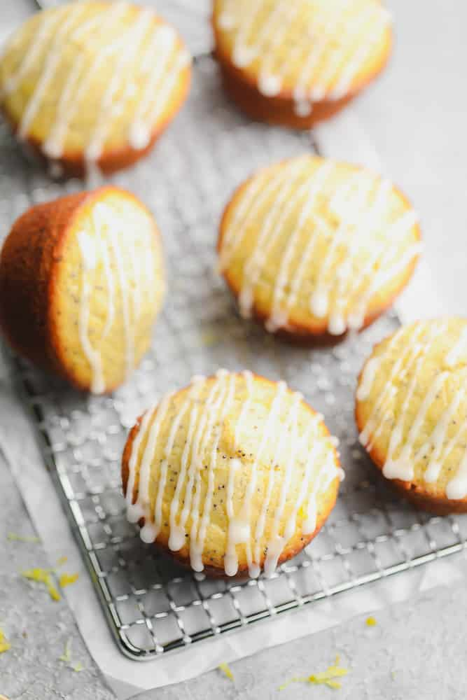 lemon muffins on a cooling rack with glaze