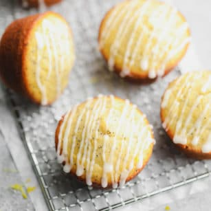 square image of lemon muffins with glaze on cooling rack